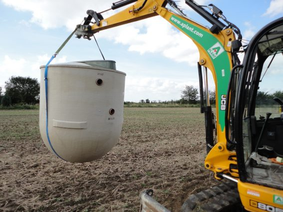 Sewage treatment plant transported to back garden for installation