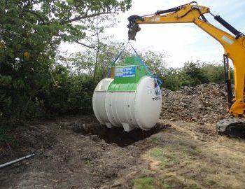 sewage treatment plant lowered into excavation