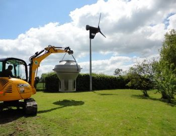 sewage treatment plant transported by excavator to the back garden