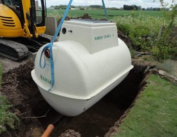 lowering sewage treatment plant into excavation
